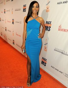 Bold: Shaun Robinson looked incredible in her blue gown with shimmering heels and sleek, s...