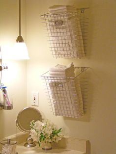 Baskets mounted to wall as towel holders. Cute idea.