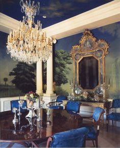 Hutton Wilkinson, Tony Duquette Inc., designed and installed the architectural details to this dining room and commissioned the late artist Julian Latrobe to mural the interior with a scene depicting a park plaisance at dusk.