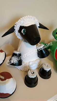 This lovely woolly terracotta sheep garden decoration is perfect to add a little flare to your garden flower beds patio or even indoors. She feature Flower Pot Art, Clay Flower Pots, Flower Pot Crafts, Flower Beds, Flower Pot People, Clay Pot People, Clay Pot Projects, Clay Pot Crafts, Painted Clay Pots