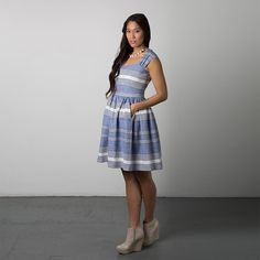 Buy a women's dress pattern for sundresses, summer dress, vintage-style dress with full skirt, gathered skirt or A-line skirt, knee length dress, sweetheart bodice and sweetheart neckline, fully lined, fitted bodice with cap sleeves, fitted waistline, and pockets. Independent pattern designer. Made in Canada. Printed paper sewing pattern.