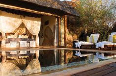 Madikwe Hills Private Game Lodge is set on a hilltop, in the heart of the malaria-free Madikwe Game Reserve. Accommodation at Madikwe Hills comprises of the main Madikwe Hills Private Game Lodge and Little Madikwe Hills - a separate family friendly camp. Kruger National Park, National Parks, Wooden Walkways, Safari Holidays, Kenya Travel, Game Lodge, Honeymoon Suite, Private Games, Game Reserve