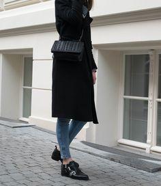 Long black coat, studded details  and patterned scarf. Black and Blue. Cut out boots. Minimalism. More on afnewsletter.com