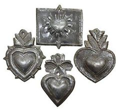 There are so many types of Valentines Day wall art available from valentines day wall clocks, Valentines Day wall hangings and other beautiful Valentines Day wall  accents.   I find all types of materials to pick from whether it be metal, wood, fabric or even glass.  With that being said check out some of the most trendy Valentines day Wall Decorations for 2018.  Milagro Heart, (set of 4), Haitian Metal , Recycled Art 3