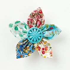 Vintage Buttons and Vintage Fabric would be great for this project. Mollie Makes always has the best ideas.  Go visit for colorful creative fun!  How to make a fabric flower brooch - Mollie Makes