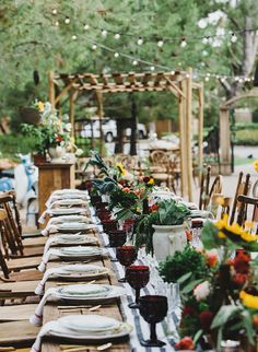 outdoor italian themed dinner party with burgundy wine glasses and green centerpieces
