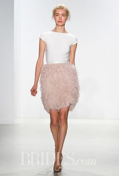 A short @kellyfaetanini wedding dress with a pink feathered skirt (perfect for a reception dress!) | Brides.com
