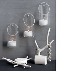 wall-mounted candle holder  | CB2 Maybe as an alternative to the mason jars? Holds tea lights and votives
