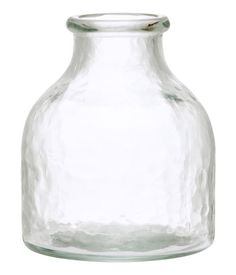 Clear glass. Small hand-blown glass vase. Diameter at top 3/4 - 1 in., height 3 1/4 - 4 in.