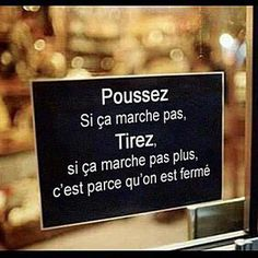 Hahaha!  (Translation: Push, If that doesn't work, Pull, if that doesn't work it's because we're closed!)