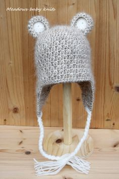 A super soft hand crocheted Teddy Bear hat. This hat is perfect for photography props, shower gift, baby or just for everyday adorableness! Your little one will look so cute wearing this hat.  Made from hairy 35% Super Kid Mohair and 65% Cotton yarns.   Size - 3-6 months  Hat circumference 45 cm / height 16 cm  CARE INSTRUCTIONS Spot clean or hand wash and lay flat to dry.  NOTE Colors may vary slightly due to difference in monitors, lighting when pictures were taken.