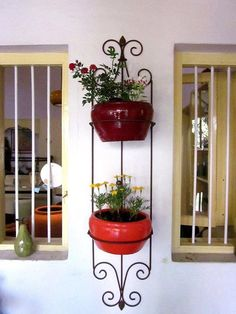 wrought-iron pot holders n  lovely terracotta planters