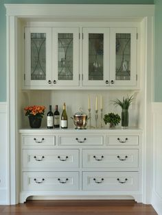 Built-in mini bar/coffee bar w glass front doors. A good idea between kitchen and dining room cabinets