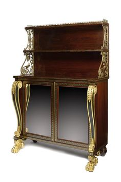 A Regency rosewood, ebony and brass inlaid side cabinet attributed to George Oakley (1773-1840).