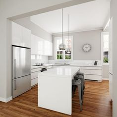 Classic modern white kitchen design. Solu-slimline handles, gloss polyurethane door fronts and Caesarstone benchtops.: