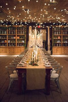 romantic candlelit reception table - photo by Sweet Root Village http://ruffledblog.com/berry-toned-wedding-at-terrain