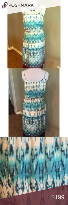 "Banana Republic Bohemian Chic Silk Dress Stay cool this summer in this batik patterned 100% silk sundress with its cool ocean colors and adjustable spaghetti straps. Meant to be worn as a blouson top, so extra comfort and coolness since it is not form fitting. Wear with or without a belt. Fully lined. Lining is polyester. Dry cleaned once and never worn. Suggested care:  Dry Clean. Necklace not included.   Approximate Measurements (unstretched):  Bust - 36"" Elastic waist - 30""  Hips- 44""…"