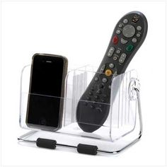 Remote Control Organizer Caddy by MarthaClaire_Home_and_Garden_Decor. $15.18. Remote Control Organizer Caddy - Home AccentsNever lose a remote again! This handy caddy with four separate slots keeps TV, stereo and other handheld remotes right within easy reach. A perfect organizer for any electronics buff! Plastic and metal. Contents not included. Measures: 7'' x 5'' x 5'' high.