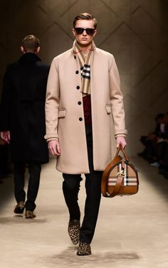 Camel bonded cashmere caban and the Boston in spotted animal print on the runway of the Burberry A/W13 Menswear show