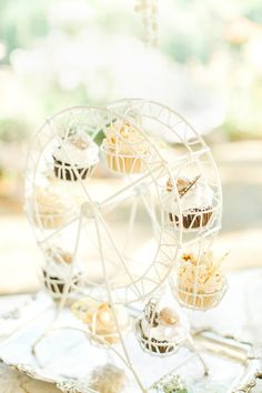 Ferris wheel cupcake display, photo by The Nolans http://ruffledblog.com/magnolia-hill-wedding #cupcakes #desserts
