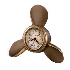 A beautifully crafted Alarm Clock in a Ship's Propeller or Screw by Howard Miller. 24 Hours and 60 Minutes display on Antique Parchment Dial. Polystone Screw finished in Antique Copper. Quartz Movement, Battery Powered, and YES battery IS included AND shipping is FREE!
