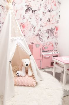 Feminine pink floral girls nursery / playroom - Using Our Glamorous Pink Playroom to Manage Toy Clutter • Chandeliers and Champagne