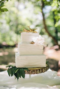 Brides: Gold Twig Cake Toppers. A rustic cake topper made of gold painted twigs.