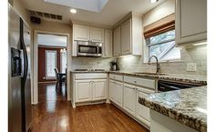 A small kitchen done right!   Very nice,   My favorite so far.    Like the tiled backsplash.
