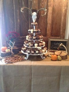 cupcakes are cute idea for grooms table no cutting necessary more football theme maybe