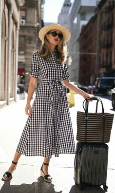 Want to win an all-expense-paid trip to the Maldives? SAME. Click to find out all the details on the insane @macys honeymoon sweepstakes. No purchase necessary. Ends 3/31/18. Official rules: macys.com/weddingsweeps // Short sleeve black and white gingham midi dress, black suede wedge sandals, wide brim tan bolero straw hat, black oval sunglasses, black and white straw tote. #classicstyle #macyslove #ad