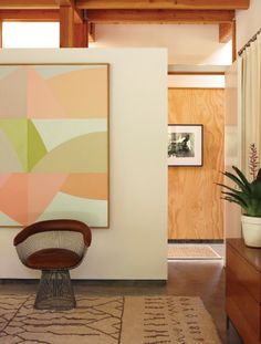 pastel geometric painting & natural wood wall
