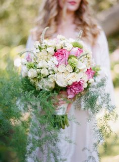 White bouquet with pink accents and trailing vines. Photo: Silvana DiFranco