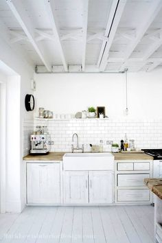 Simple white everything, farmhouse sink and subway tile