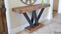 Six structural lumber boards, cut and put together to make a rustic and unique console table perfect for any entryway. Diy Entryway Table, Farmhouse Entryway Table, Diy Sofa Table, Rustic Console Tables, Entry Tables, Farmhouse Furniture, Rustic Entry Table, Rustic Entryway, Farmhouse Bench