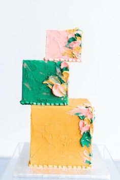 Whimsical Modern Art Gallery Wedding with whimsical three tier square cake in pink, mint and golden yellow. #wedding #confettidaydreams #weddingplanning #mintwedding #modernwedding #whimsicalwedding #weddingflowers #weddingideas #weddingdecor