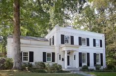 """John and Jason are only the third owners of the Regency Revival home with a white exterior and black shutters, which was built in the 1930s. """"There's very much an English sensibility to the house,"""" says Jason."""