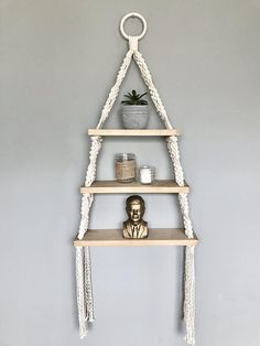 Macrame Triple Hanging Shelf (Triangle)-- Perfect for succulents, air plants, knick-knacks, spices & more! // SIZING // Please note that sizing is approximate: Height from top of ring to bottom of fringe: 45 Depth: 5 Length of shelves: 11.5 (top), 14 (middle), 16.5 (bottom) // MADE TO
