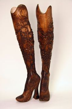 McQueen's Romantic Naturalism: Hand-carved prosthetic legs in elm wood, originally worn on the runway by double-amputee model and athlete Aimee Mullins.