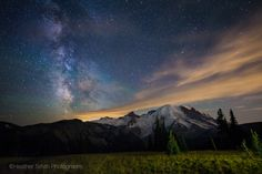 https://flic.kr/p/vknKC6 | Mt. Rainier basking in the light of the Milky Way | On a whim, decided to take a trip down to Mt. Rainier on a dark night.  The sky was unpredictable, clear one minute then a blast of cloud the next.  I just thought this cloud was so awesome the way it seems to burst out of the Milky Way.  Pretty streaks of green air glow to add more color.  Did a little light painting in the foreground to give some perspective.  Had a great time with my friend hanging out and…