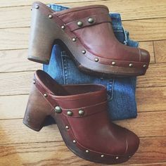 🌻UGG Australia Jolene leather Clogs🌻 Looking for a clog with just a little bit higher heel?!! Here it is!👍🏼super clean!!🌸 hardly worn!! 👏🏼 gold studs~brown leather~4 inch wooden heel! Open back! Sheepskin lined! the marks on the insoles are from the sticker! bottom soles look great!! Just has left over sticker marks! Tiny scuff top of right clog, tiny black scuff on left top of shoe! Make an offer!✌🏼️💛🌻☺️ no trades thank you UGG Shoes Mules & Clogs