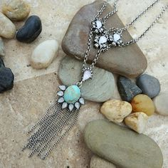 "Faux Turquoise Moonstone Silver Pendant Necklace Soft and beautiful mixed stone layer necklace featuring faux turquoise center stone, and iridescent semi precious stones that practically glow in hues of purple and mint. Delicate fringe accent and crystal clear rhinestones finish the look. Inside chain measures approximately 16"" and extends a further 2"" with extender. Center pendant measures approximately 3"". (104L518) Jewelry Necklaces"