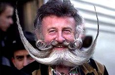 Gerhard Knapp of Germany, one of 80 delegates of the Association of German Beard Club, gets off the train in Reno