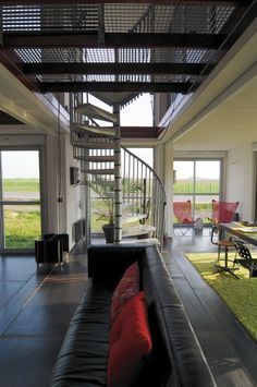 first-floor-shipping-container-house; could a similar thing be done with wood decking rather than metal grate work?