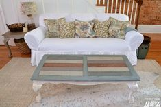 How to refinish and stain a table. I love the multi-colored stain on this coffee table. What a wonderful makeover.