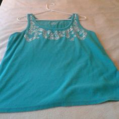 Teal lane Bryant tank top Teal lane Bryant  tank top with detail around  the colar. No gems ate missing.  Excellent condition!  Make an offer! Lane Bryant Tops Tank Tops