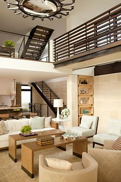 Contemporary Great Room with Carpet, Cathedral ceiling, Pendant Light, Built-in bookshelf, Chandelier, French doors, Loft