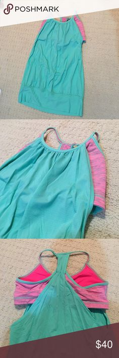Lululemon tank Lululemon built in bra workout top. Loose fitting but holds you in up top. Also band around bottom so shirt isn't totally loose and won't fall over your head when you're in downward facing dog. Watermelon colors! lululemon athletica Tops Tank Tops