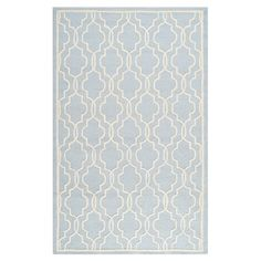 Anchor your living room seating group or define space in the den with this artfully hand-tufted wool rug, featuring an overlapping ogee motif for eye-catchin...