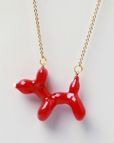 Charming balloon animal necklace. I'd wear it everyday.