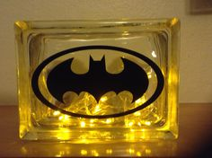 """ANOTHER SPECIAL ORDER """"BATMAN"""" WITH SIMPLE BLACK RIBBON EMBELLISHMENT AND YELLOW LED BATTERY OPERATED LIGHTS. Laser etching by Lavene & Co."""